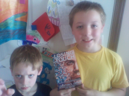 The boys had different reactions to posing with my book. I guess I can't blame them.