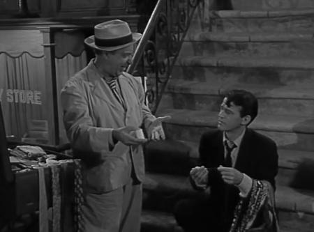 Lou Bookman (Ed Wynn) makes his pitch to Death (Murray Hamilton).