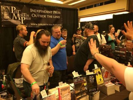 Pouring Malört at the Post Mortem Press table.